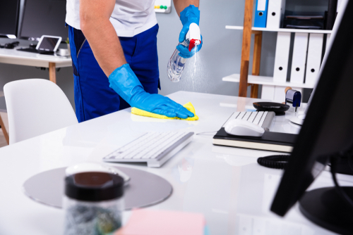 a cleaner is performing cleaning services mississauga in an office
